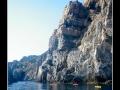 Canoeing under cliffs